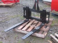 Tractor mounted pallet forks, buckets