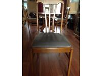 Solid wood circular ( extendable) dining table & 4 chairs.