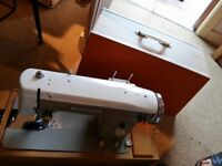 Sewing machine with box