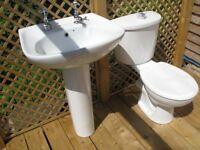 Modern white bathroom sink & toilet, new and unused.