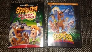 2 Scooby Doo DVD's & 4 Scooby 100 piece puzzles