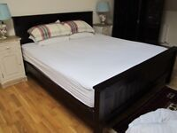 Super king-sized pine bed with memory-foam topped mattress.