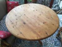 Round pine table