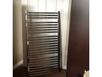 Heated towel rail with fittings