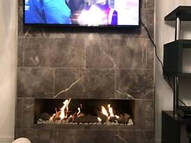 Frameless open fronted gas fire with Logs