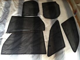 Custom made sun/privacy screens for Ford Focus estate.