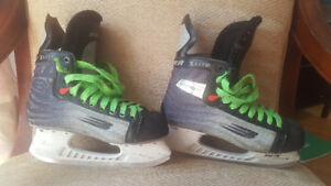 2 pairs of hockey skates for sale