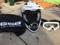 White motocross helmet, goggles and race suit