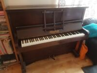 Upright Piano by Heins & Co