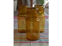 Three amber coloured storage jars with stoppers to keep contents fresh.