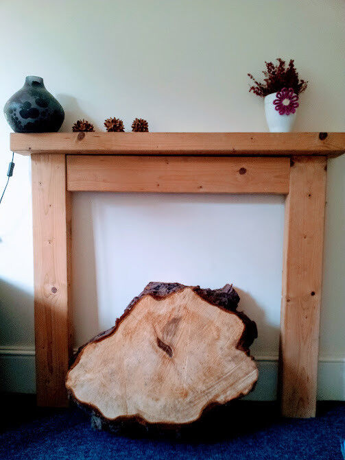 Unvarnished wood fire surround or shallow wall shelf