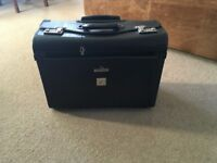 High quality sturdy black leather wheeled business case