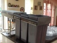 Recycling bins never used. Pull out bins fit into kitchen cupboard.