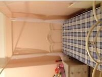 Four poster ivory single bed .