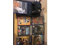 PlayStation 2 with 8 games & 1 controller