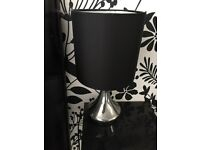Two black and silver touch lights