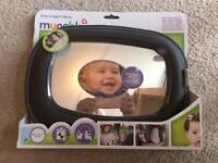 Baby munchkin in site car mirror