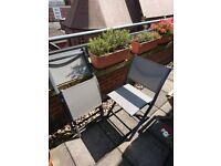 2 grey folding chairs