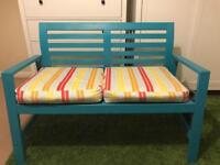 Blue bench with padded cushions