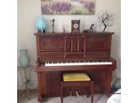 Piano for sale, to include piano stool.