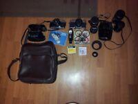 CANON AV-1 + MINOLTA SRT100B + LENSES + FILTERS + FLASHES + BAG