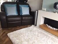 Two brown leather recliner sofas