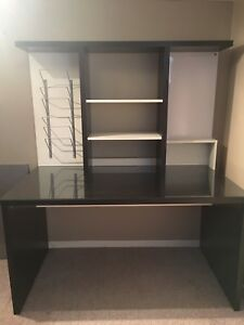 Home office desk with shelves and white board