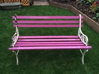 Pink garden bench with cast iron ends