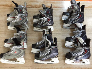 6 Pairs of Bauer Hockey Skates, Sizes 4 to 7, New and used.