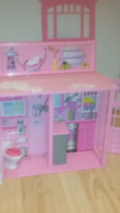 Bratz and barbies and house