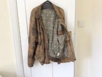 Men's leather jacket size L . Mottled brown with paisley lining.