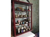 Antique vintage shop shelf with original tins, bottles and medicines