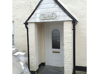 White UPVC Front Door with decorative glazed upper panel