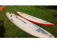 2 windsurfing boards, masts, booms and sails