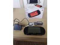 Sony psp mint conditon comes woth new song headphones charger and 1 game