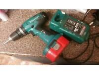 Makita drill and charger