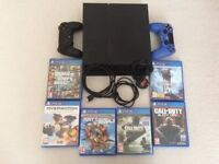 Playstation 4, 2 Controllers (one with grip), all leads and 6 Games