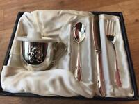 Silver plated beaker and cutlery set.
