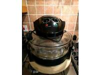 Air fryer - almost new. Comes with all attachments and gadgets. Kitchen appliances