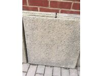 12 Buff coloured paving slabs, 60cm by 60cm