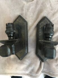 Pair of stained oak single bulb socket wall lights.
