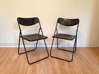 Two Black Plastic Folding Garden Chairs
