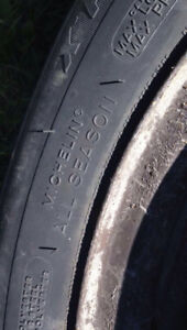 Like new MICHELIN 185/65r/14s on steelies