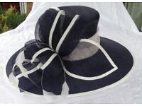 Phase Eight wedding hat navy with almost white trim. Worn once!