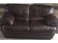 Brown leather two seater sofa from DFS