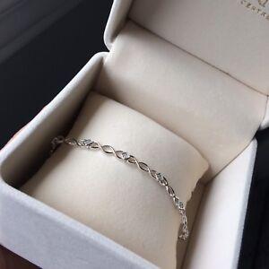 10k WHITE GOLD .09OCTW DIAMOND INFINITY BRACELET