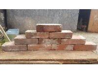Red reclaimed bricks and yellow modern engineering bricks for sale