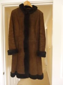 1970 Retro Women's Sheepskin Coat. Size 12. Knee length. Dark brown sheepskin with black fur.