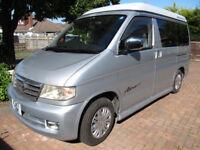 Mazda Bongo camper van. 4 seater van with Auto Free Top and Vango Airway Idris II awning tent.