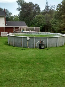 Above ground swimming pool 27ft round -48 inch sides